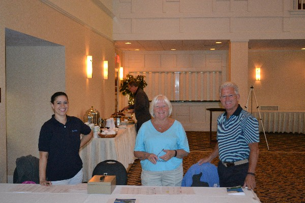 From l-r, Michelle Stewart; Claire Goulet, chapter vice president, operations; and Chris Hitchcock staff the registration desk at the annual chapter fall golf tournament in September.