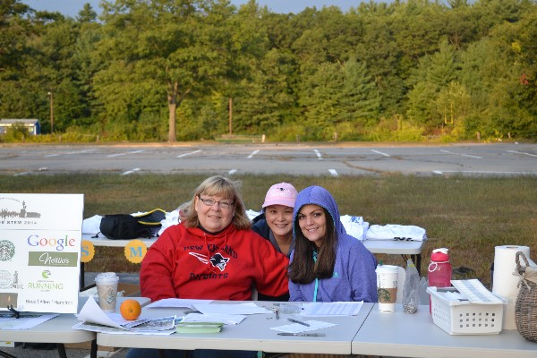 Denise Rich (r) Young Doane (c), and Melanie Distaula from Oasis Systems register runners for the annual 5K Family Fun Run/Walk for STEM (science, technology, engineering and mathematics) Education benefitting STEM scholarships in September.