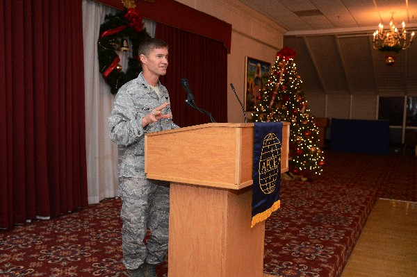 Maj. Gen. Craig Olson, USAF, program executive officer for C3I and Networks, addresses guests at the chapter's December social.