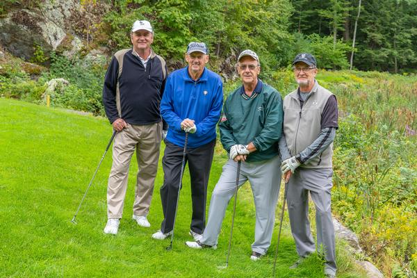 First-place winners in the September golf tournament's second flight are (l-r) Connie Gath and Tom, JC, and Paul Corcoran.