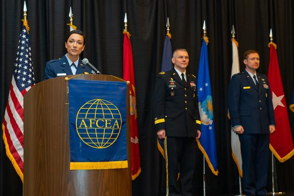 Capt. Rachele Szall, USAF (l), master of ceremonies at the annual ROTC awards luncheon in April, introduces the keynote speaker, Brig. Gen. Vincent Malone, USA (c), deputy commanding general, Combat Capabilities Development Command (CCDC) and senior commander, Natick Soldier Systems Center and Col. Riley Pyles, USAF, chapter vice president, ROTC affairs.