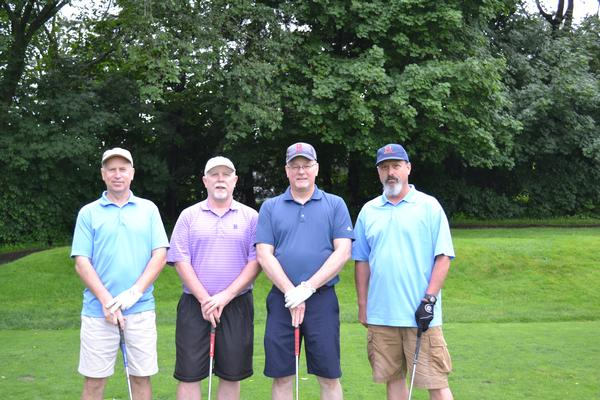 First place winners, first flight (l-r), Jeff Hall, David Markuson, Pete Krawczyk and Tim Nickerson, are all smiles after beating the completion at the chapter's June golf tournament.