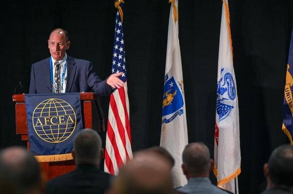 Keynote speaker Kevin Fahey, assistant secretary for acquisition, Office of the Secretary of Defense, U.S. Department of Defense, discusses the Defense Department's efforts to transform the acquisition process during the 42nd New Horizons Symposium in March.