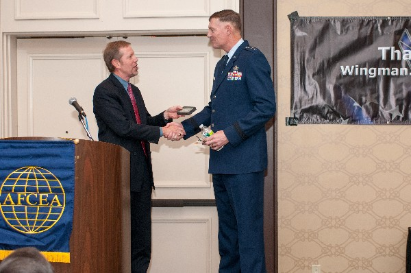Scott Hardiman, chapter president, presents a memento of appreciation to Lt. Gen. Andrew E. Busch, USAF, vice commander, Air Force Materiel Command, for his address to the chapter�s November guest series luncheon.