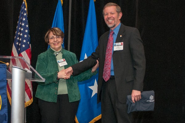 Scott Hardiman, chapter president, congratulates Marie McClanahan on her selection as the chapter�s AFCEAN of the Quarter in February.