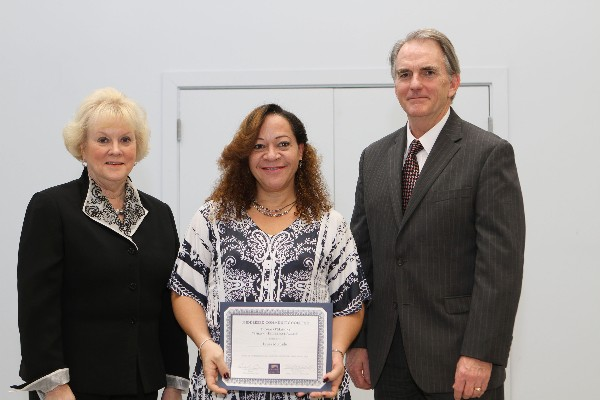 Laura Mercado (c), a student at Middlesex Community College (MCC), receives the 2012-2013 Thomas O�Mahony Spirit of Excellence Award in March while Carole Cowan, president of MCC, and Jay Linnehan, MCC executive vice president and executive director of the MCC Foundation, stand witness.