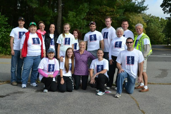 The Young AFCEAN team and other volunteers celebrate the successful inaugural 5K Family Fun Run/Walk in September.