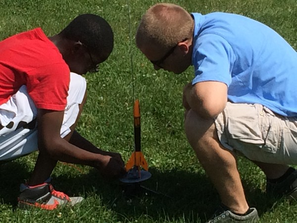 Hanscom Middle School students prepare their rocket for launch at the school's Rocket Day, held on Hanscom Air Force Base in June.