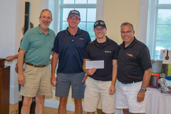 Attending the Elmer J. Fuller Golf Tournament in June are second flight winners (l-r) Doc Sweitzer, Integrity Applications; Rob Smith, Boeing; Ron Pioccone, Rockwell Automation; and Bob Paradiso, Quantech Services.