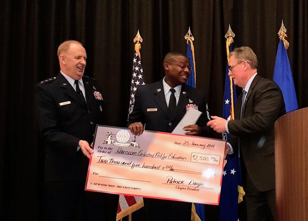 Lt. Gen. Robert McMurry Jr., USAF, commander, AFLCMC (l), joins Dagle in presenting a chapter contribution in January to Chief Master Sgt. Henry Hayes, USAF, 66th Air Base Group, command chief (c), to support the Hanscom Enlisted Education Fund.