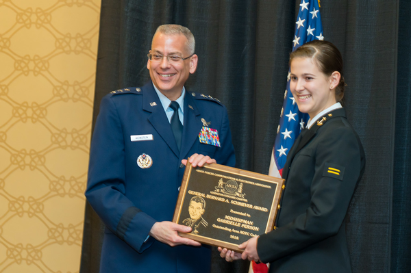 Gen. Weinstein congratulates Massachusetts Institute of Technology Midshipman Gabrielle Person in April on receiving the Gen. Bernard Schriever Award. The award is presented annually to the top midshipman or cadet in the Northeast.