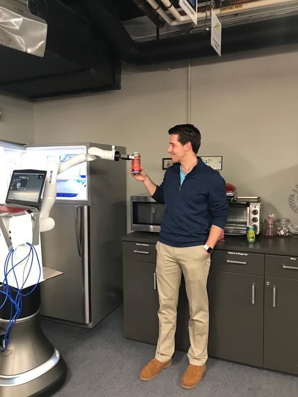 In November, Keller has fun with one of the many robots available to startups in the shared workspace innovation laboratory at MassRobotics.