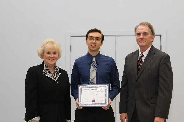 In March, Middlesex Community College student James Kuczynski (c) of North Billerica receives a chapter scholarship from Cowan and Linnehan.