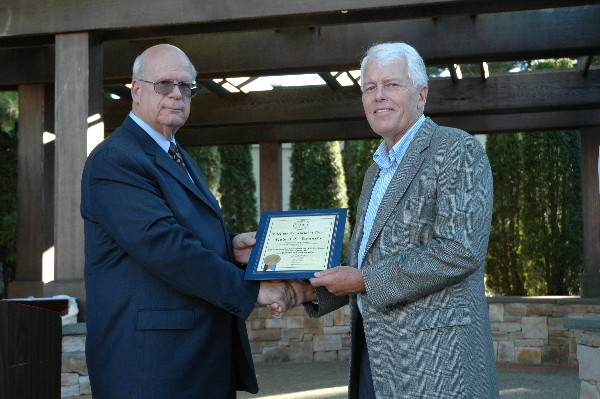 Kent Schneider (l), president and chief executive officer, AFCEA International, presents Kennedy with a Lifetime Achievement Award in August prior to his retirement as regional vice president.