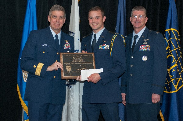 In April, Adm. Abel (l) joins Col. Scott Owens, USAF (r), chapter vice president for ROTC affairs, in congratulating Cadet James O�Connor, Air Force ROTC, Worcester Polytechnic Institute, as the chapter's ROTC Gen. Bernard Schriever Scholarship Award winner.