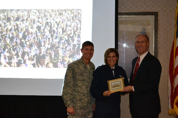 Maj. Gen. Craig Olson, USAF (l), program executive officer for C3I and networks, joins Vazquez (r) in presenting Gen. Crider with a small memento in thanks for her presentation on the Joint Information Environment and its impact on the Air Force at a breakfast meeting in December.