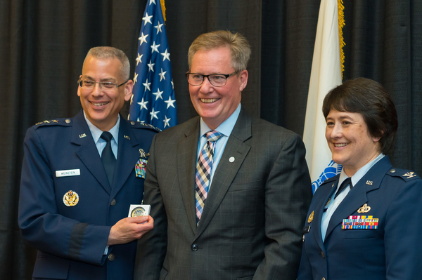 Gen. Weinstein (l) accepts a token of appreciation for giving the keynote address at the chapter's annual ROTC awards luncheon in April from Chapter President Pat Dagle (c) and Col. Amanda Kato, chapter vice president, ROTC affairs.