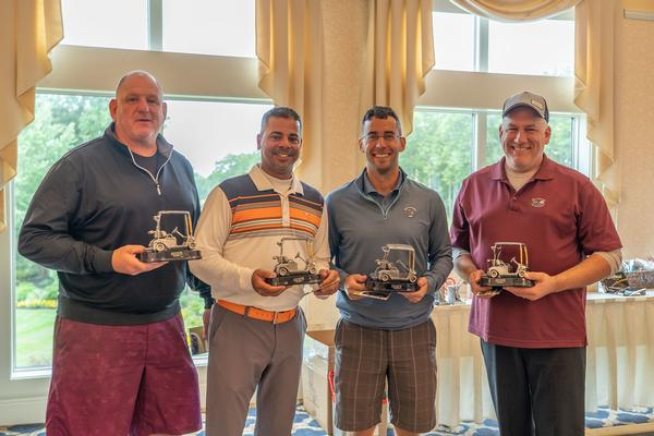Nabbing first place in the first flight at the chapter's September golf fundraiser are (l-r) Steve Ramos, Mark Webb, Shawn Perrine and Matt Andrate.
