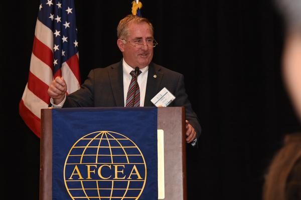 Stephen Falcone, director of engineering, Digital Program Executive Office, Hanscom Air Force Base, Massachusetts, former chapter president and board chairman, addresses students at the chapter's annual Fellowship Awards Banquet in May.