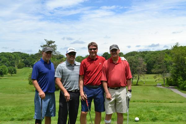 Enjoying their day on the course in June are (l-r) golfers Don Ashe, Capt. Mike Walsh, USAF, Trevor Haak and Greg Doran.