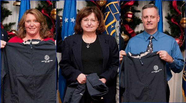 Hanscom Air Force Base Unsung Heroes recognized at the December meeting are (l-r) Sandy Davison, contracting; Donna Bibeau, 66th Air Base Group; and Scott Thibodeau, Battle Management Directorate. Not pictured is Erika Carey.