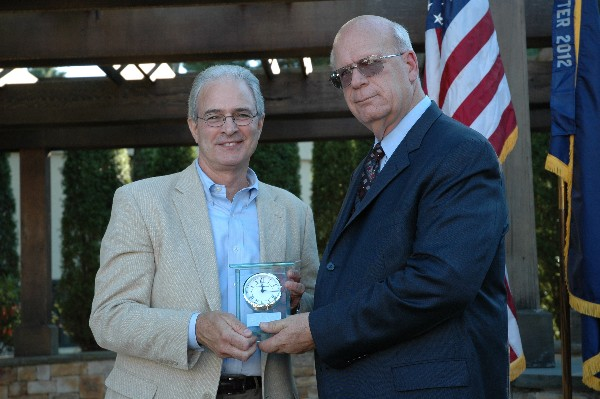At the chapter's August social, Schneider (r) presents Dave LaRochelle, former chapter president and board chairman, with the AFCEA International Award for Leadership.