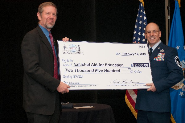 In February, Hardiman presents a $.2500 check to Senior Master SSgt. Huberty for Hanscom's Enlisted Education Fund.