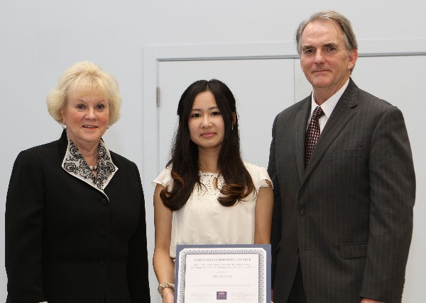 Meng Shi Ou (c), a student at Middlesex Community College, is awarded a chapter scholarship in March from Cowan and Linnehan.
