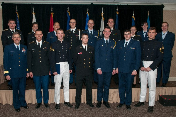 Adm. Abel (front row, l) joins 15 of the chapter�s 21 ROTC scholarship recipients honored in April.