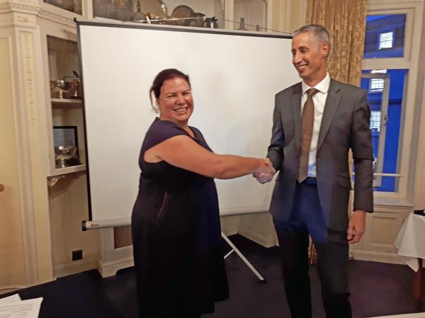 Air Commodore Nick Lloyd (Ret.), deputy chief information security officer and head of cyber security plans and engagement, Maersk, formally hands over to Jacqui Chard as the new chapter president.