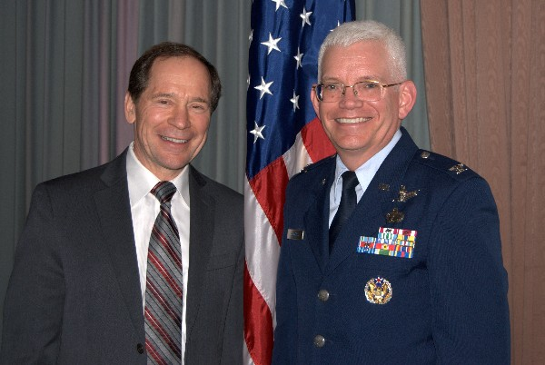 Together at the February chapter luncheon are Spencer Bauer, chapter president, and guest speaker Col. William R. Hodgkiss, director of Launch and Range Systems Directorate, Space and Missile Systems Center, Air Force Space Command, Los Angeles Air Force Base, California.