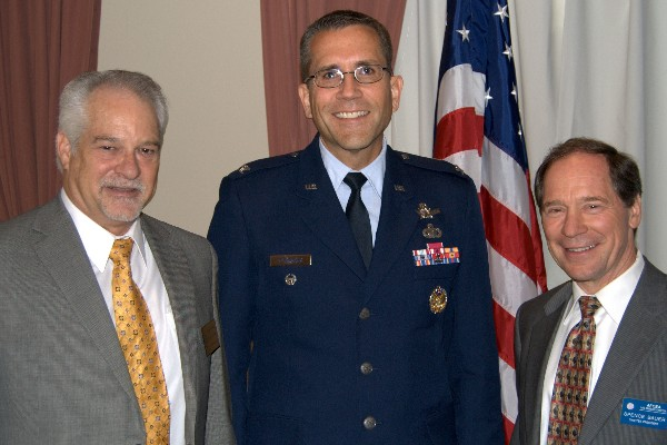 Col. James Planeaux, USAF (c), director, Infrared Space Systems Directorate, Space and Missile Systems Center, joins Doug Holker (l), regional vice president, and Spence Bauer, chapter president, at the chapter's May meeting.