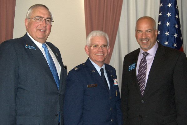 Col. William R. Hodgkiss, USAF (c), director of the Launch Systems Directorate, Space and Missile Systems Center, Air Force Space Command, Los Angeles Air Force Base, joins Dr. Steve Quilici (l), chapter president, and Adam Feingold, chapter vice president of programs, following the colonel's presentation to the chapter in April.