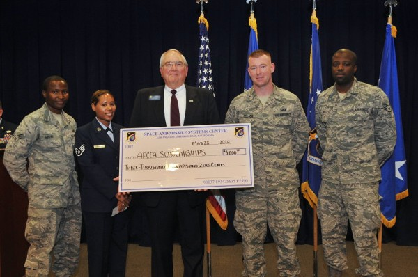 At the Los Angeles Air Force Base Community College of the Air Force graduation ceremony in May, the chapter awards scholarships totaling $3,000 to four airmen.  Pictured are (l-r):  Senior Airman Levi Mburu, USAF, Staff Sgt. Amanda Holmes, USAF, Chapter President Steve Quilici, 1st Lt. Justin Tullos, USAF, and Staff Sgt. Raymond Ball Jr., USAF.