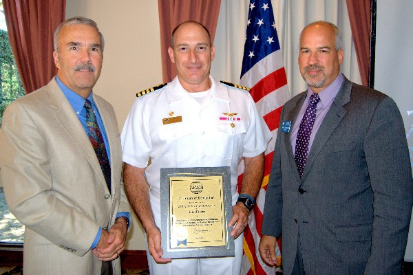 Steve Scott, chapter vice president, membership (l) and Adam Feingold, chapter vice president, programs (r), present a Certificate of Recognition in July to guest speaker Capt. Jeffrey P. Marshall, USN, for his AFCEA lifetime membership. Capt. Marshall is the commanding officer of the Naval Satellite Operations Center, Point Mugu, California.