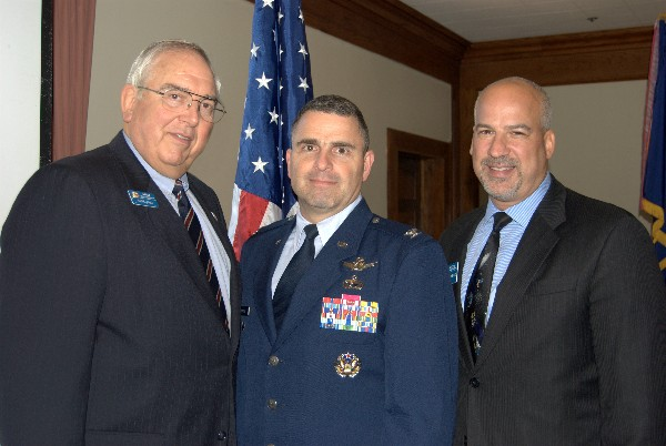 Steve Quilici, chapter president (l), and Adam Feingold, vice president of programs (r) greet August speaker Col. Bill Cooley, USAF, director, Global Positioning Systems Directorate.