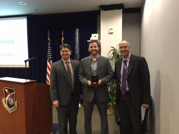 Awards Chairman Doug Skinner (l) and Chapter President Bill Page (r) present Nicholas Farinacci of TEKsystems AFCEA International's Emerging Leadership Award at the chapter's February lunch meeting.