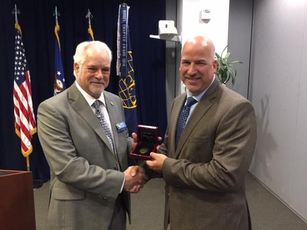 Chapter Past President Adam Feingold (r) receives the AFCEA Leadership Award from AFCEA Regional Vice President Douglas Holker at the July chapter meeting.