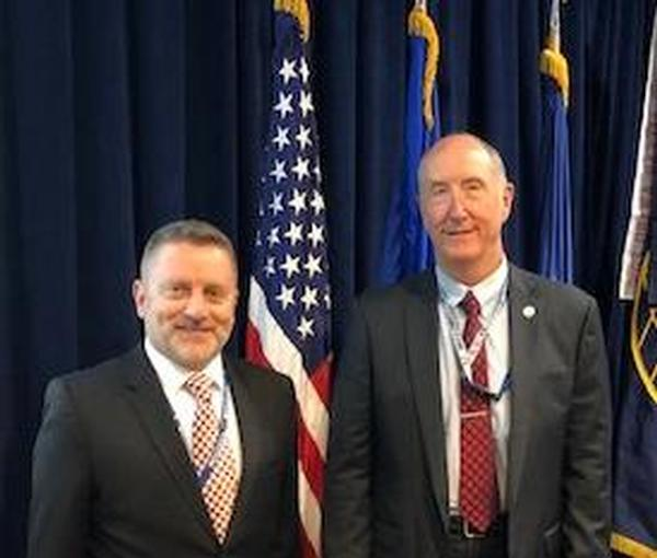 Col. Scott Beidleman, USAF (Ret.), chapter president (l), poses with Steve Pluntze, executive director and civilian deputy director, Remote Sensing Directorate, Space and Missile Systems Center, Los Angeles, at the July meeting.