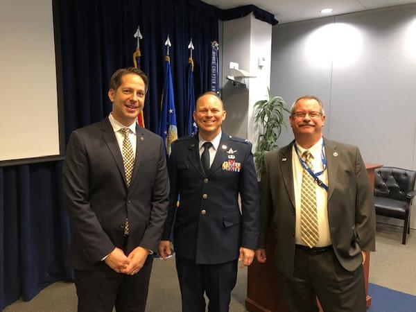 (From l-r) Michael Plantenga of Omni Consulting and chapter vice president of programs, is pictured with Col. Wallace