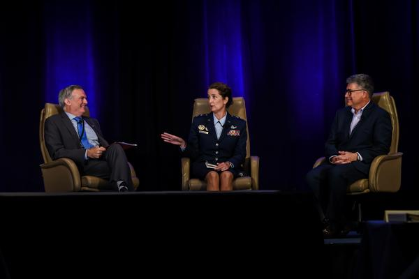 Panelists (from l-r) Maj. Gen. Martin Whelan, USAF (Ret); Maj. Gen. Nina M. Armagno, USAF, director, Space Programs, Office of the Assistant Secretary for Acquisition, Washington, D.C.; and Michael Dickey, director, Enterprise Strategy and Architectures Office and the Air Force Space Command chief architect at Air Force Space Command Headquarters, Peterson Air Force Base, Colorado, participate in a fireside chat at the SMC Space Industry Days in October.