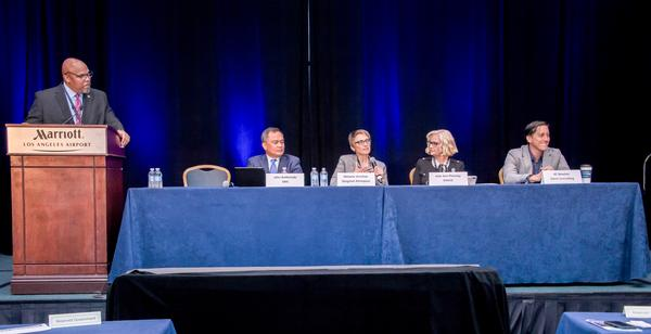Panelists (from l-r) Will Strozier, SMC's Office of Small Business Programs; John Baldonado, SMC; Melanie Stricklan, Slingshot Aerospace; Julie Ann Phinney, ENSCO; and KC Newton, CEO, Omni Consulting, discuss small business concerns at the Space Industry Days in October.