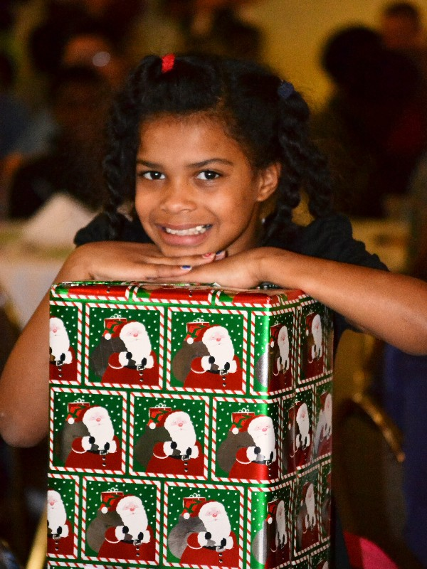 Eighty-two children from the Methodist Home for Children receive Christmas gifts and a holiday celebration in December with help from the chapter and surrounding community.
