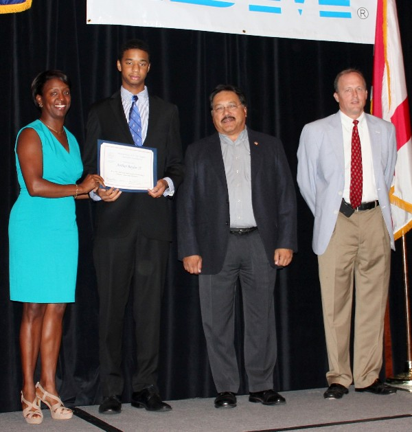 Arthur Baylor (2nd from l), a senior at Booker T. Washington Magnet High School, accepts his High School Information Technology Summer Internship certificate from Charisse Stokes, director of the chapter's Education Foundation, in June. Alongside Baylor is his corporate sponsor Bill Woodhouse (2nd from r), chief executive officer of eSolution Architects, and Dr. Joe Besselman, chapter president.