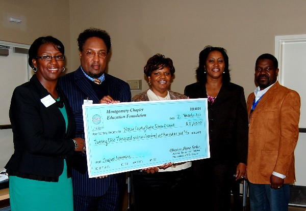 In November, Charisse Stokes (l), director, chapter Education Foundation, presents Dr. Melvin Lowe (2 from l), Dr. Jacqueline Brooks (2 from r), a school board member (c) and Christopher Clark, a Career and Tech Center instructor (r), with a Chapter Initiative Grant valued at more than $20,000.