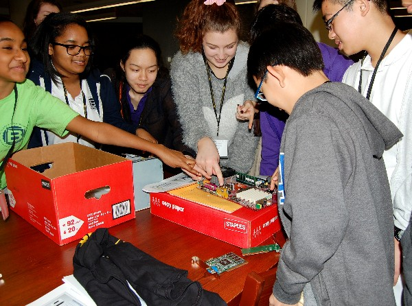 Students race to identify components of a motherboard during the Fixing a Computer mini-camp session of Camp IT in February.
