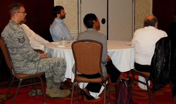 In March, Business Over Breakfast attendees listen attentively to a presentation from Col. Ted Lowry, USAF (Ret.), on