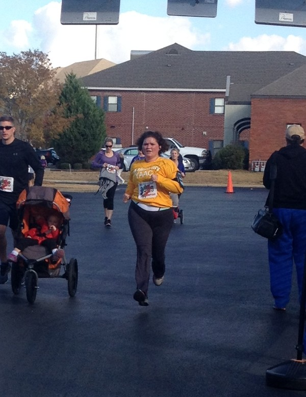 Master Sgt. Cheryl Chowning, USAF, finishes the Turkey Burner 5K strong in November.