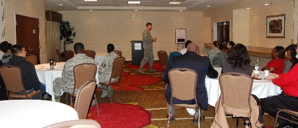 Col. Michael Jiru, USAF, senior materiel leader and chief of the Enterprise Logistics Systems Division, Business and Enterprise Systems Directorate, Maxwell Air Force Base-Gunter Annex, speaks to Business Over Breakfast attendees in December about leadership.