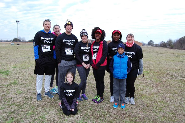 Team YAAC smiles before heading off into the Centerpoint 5K and Half-Marathon races in February.